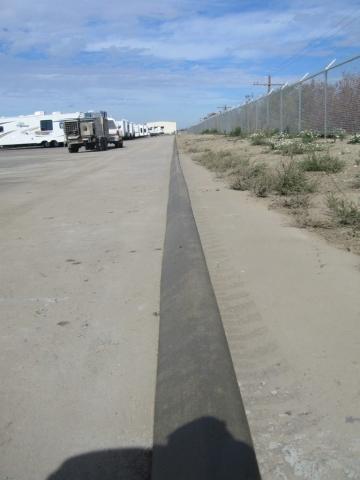 5X6 pinned on asphalt curb a 600 foot long line