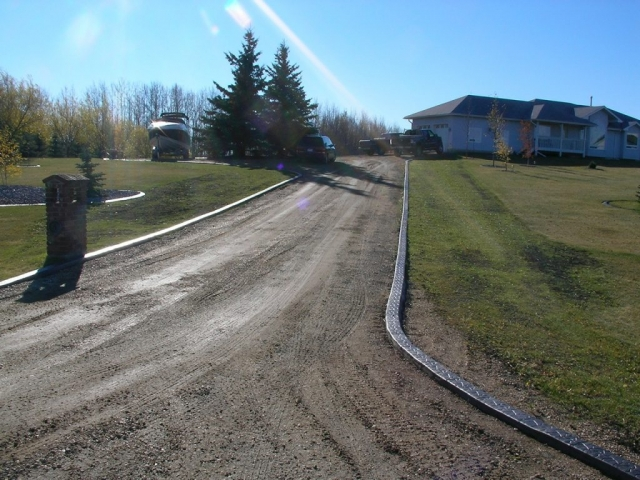 Flat top curb as driveway edging