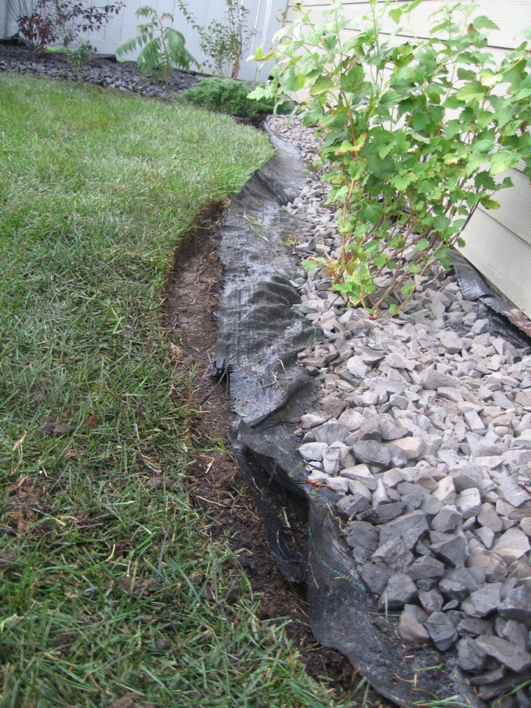 homowner pulled out plastic , pushed back rock and reshaped it. Very good!