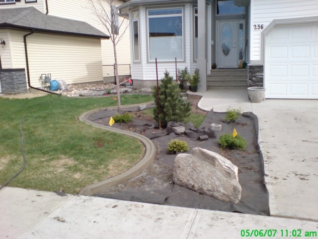 we cleaned up the rough edge and installed this curb