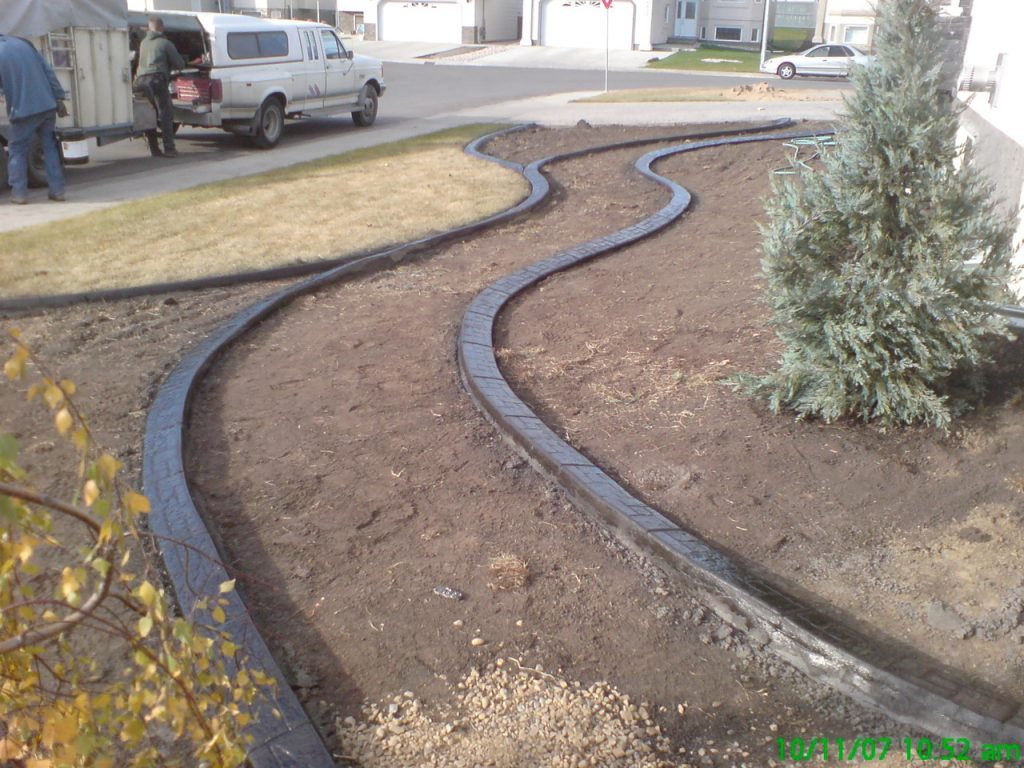 curb breaks up a big blank side yard