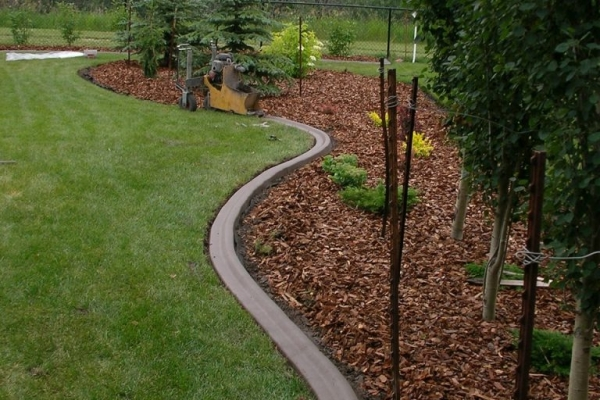 extruding curb around existing bed